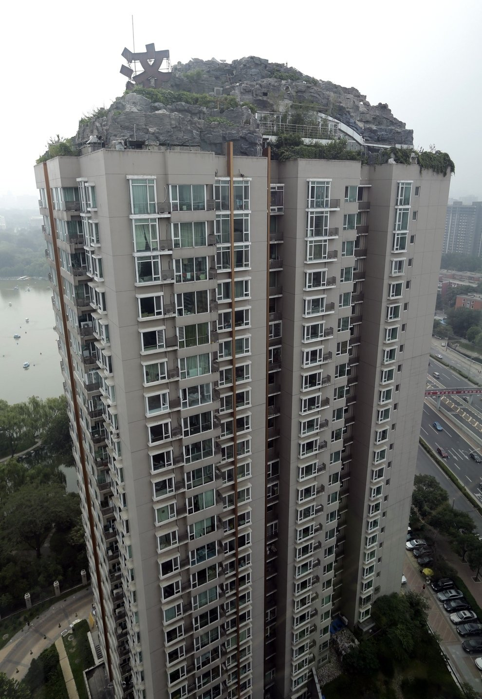 1 - chinese man builds mountain on residential suite