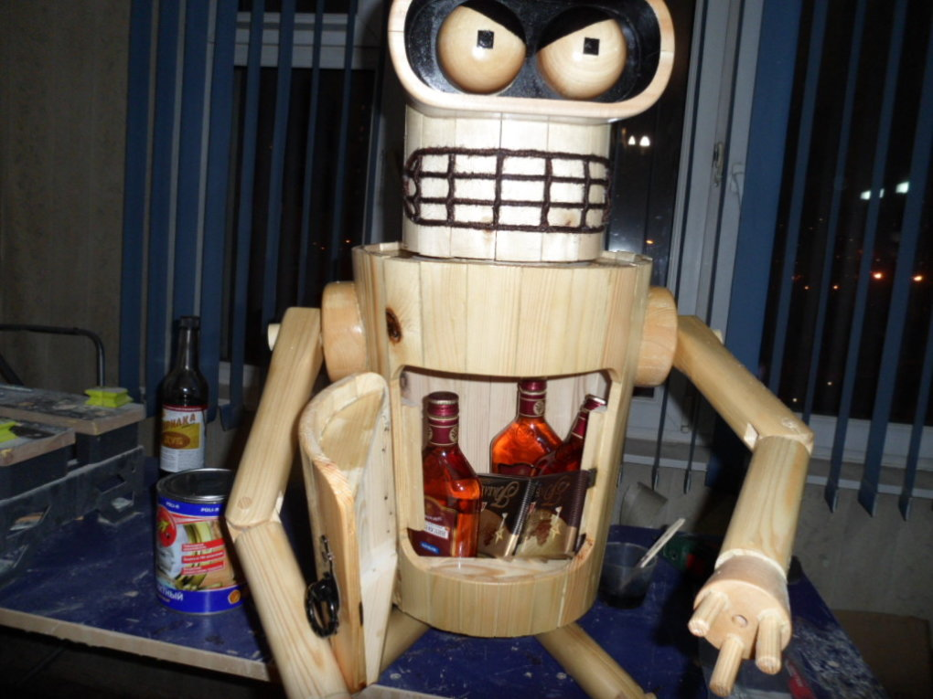 1482688926117766783 - robot bender made from the wood