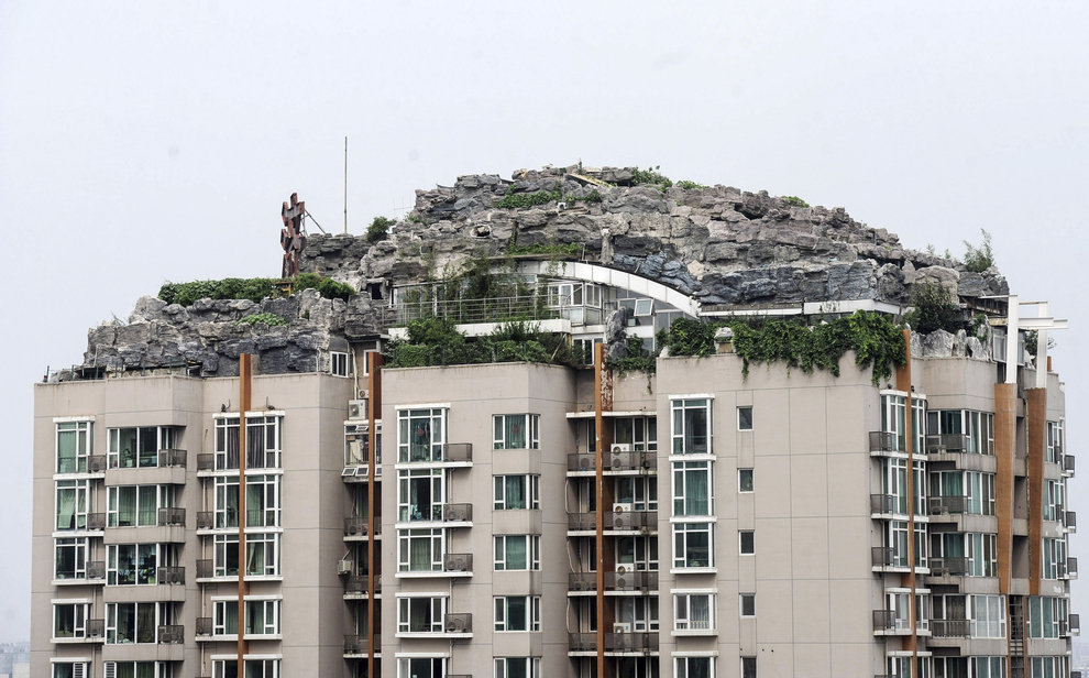 3 - chinese man builds mountain on residential suite