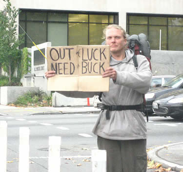 3 - homeless people with funny signs