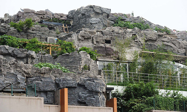 4 - chinese man builds mountain on residential suite