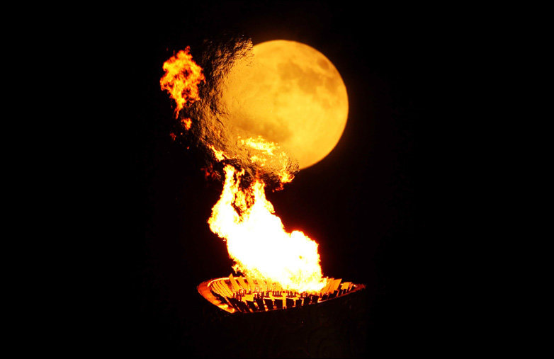 44933841 flame - olympic torch is lightning the moon