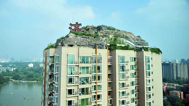 5 - chinese man builds mountain on residential suite