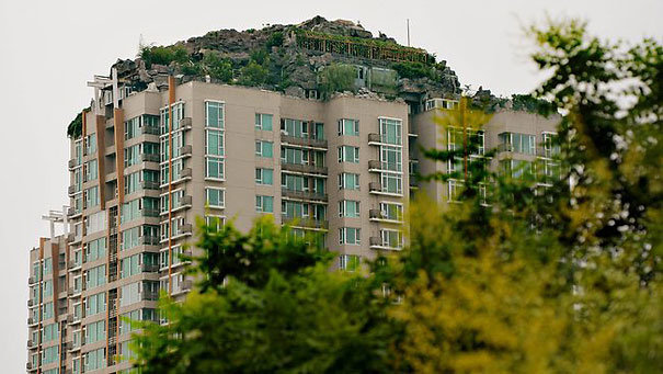 6 - chinese man builds mountain on residential suite