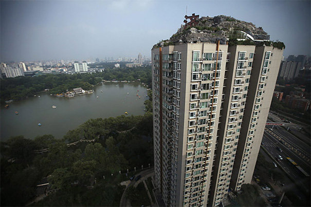 8 - chinese man builds mountain on residential suite