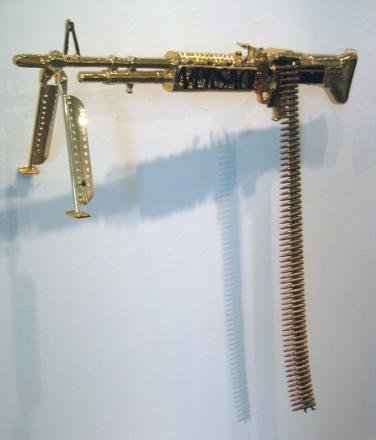 versace - dolce, gucci, versace & others: guns & chainsaws