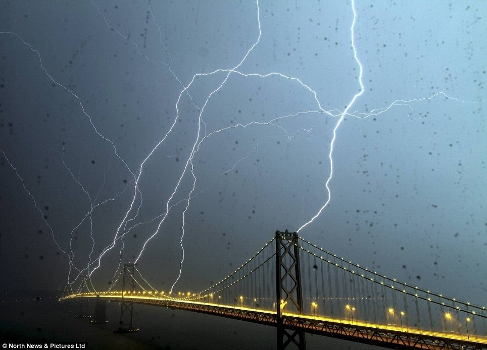 another awesome pic san frans bay bridge being hit lightning night