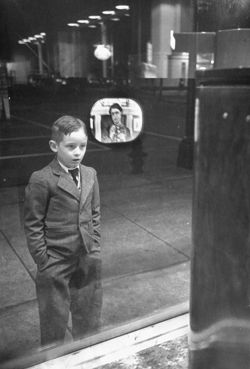 boy watching for first time appliance store window
