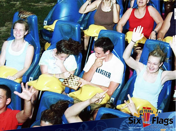 chesscoaster w - people playing chess on roller coasters