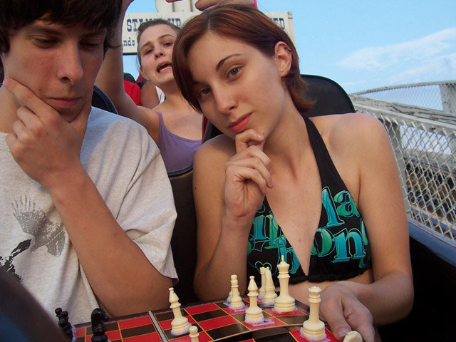 coasterchess 640 - people playing chess on roller coasters