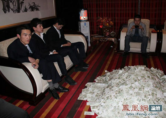 count - chinese businessman pays a restaurant bill like a boss.