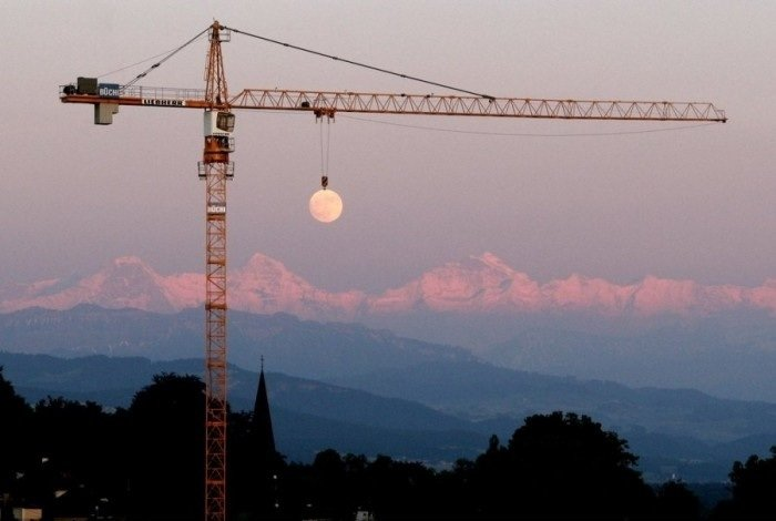 crane lifting moon