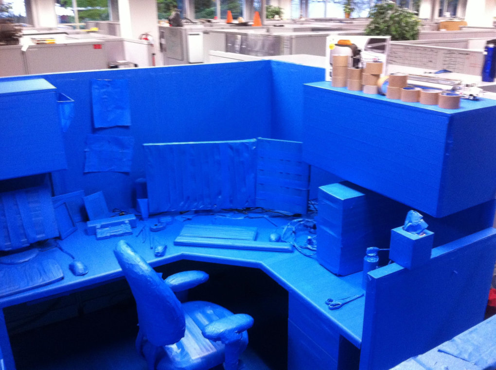 cubicle everything covered blue painters tape down every individual pencil long