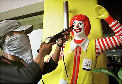 demonstration muslim protester points his toy gun ronald mcdonald