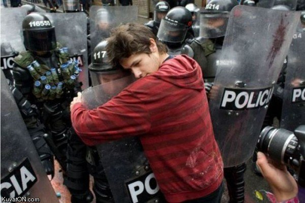 even riot police need hugs