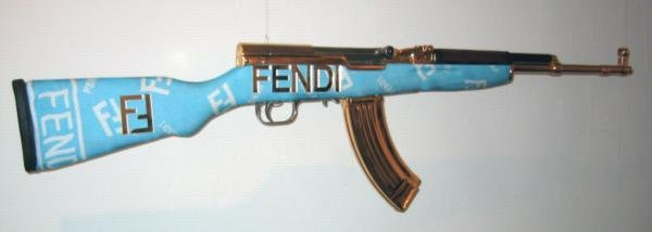 fendi - dolce, gucci, versace & others: guns & chainsaws