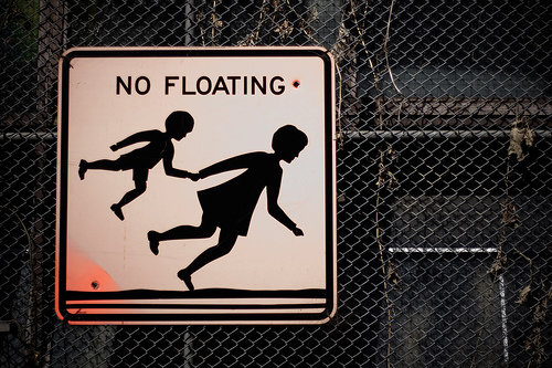 funny sign floating