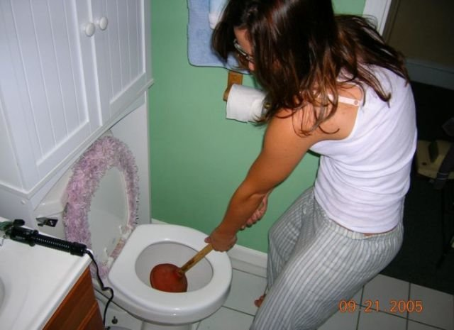 girls unclogging toilets