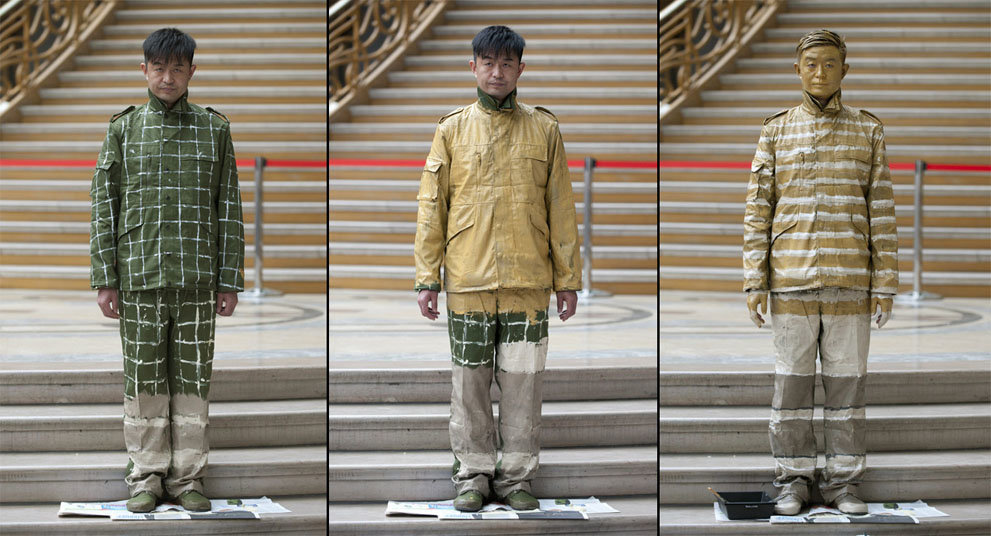 liu bolin transforms himself into invisible man