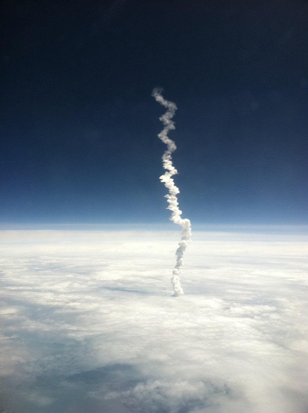 shuttle - awesome smoke trail after nasa shuttle launch, view from plane window