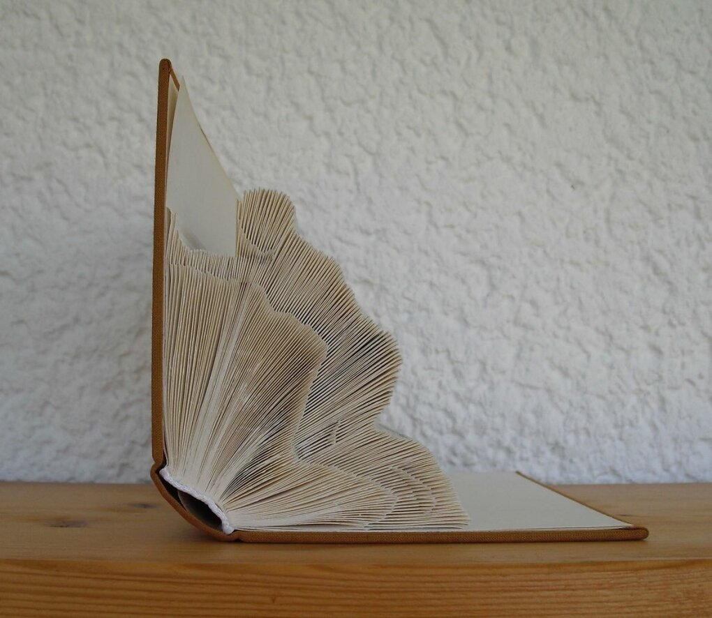 figurine appears keep books from falling