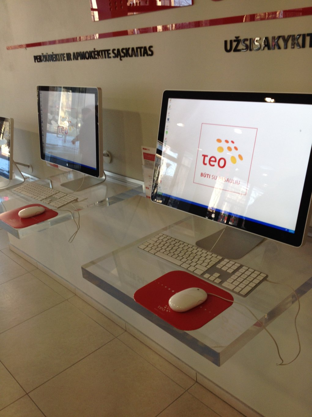 xp - huge expensive apple monitor, apple keyboard, apple mouse and wait... what? windows xp at the biggest telecommunication company in lithuania